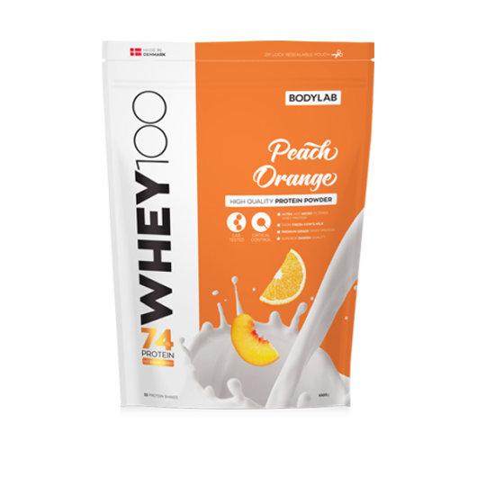 Proteini Whey 100 Bodylab u narančastoj ambalaži okusa breskve i naranče od 1000 grama