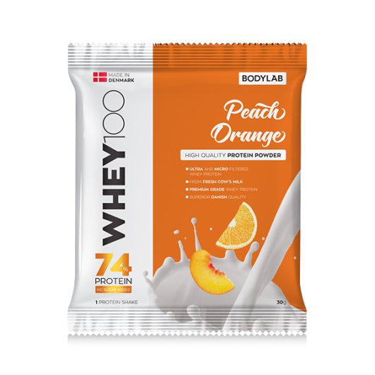 Proteini Whey 100 Bodylab u narančastoj ambalaži okusa breskve i naranče od 30 grama