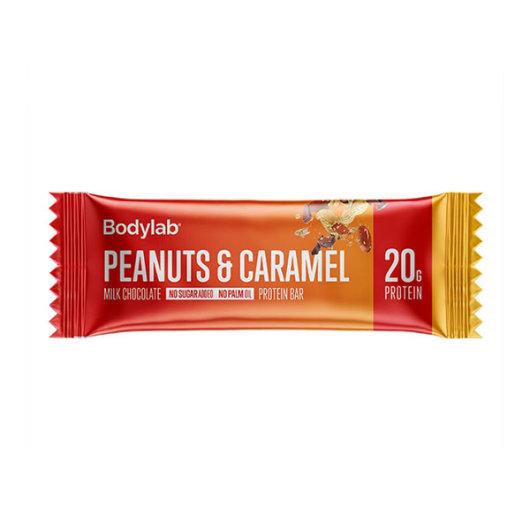 Proteinska čokoladica Bodylab u crveno žutoj ambalaži okusa kikirikija i karamele od 60 grama